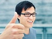 Young man, Asian, student with glasses, smiling, thumbs up gesture, optimistic, positive