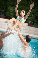 Family splashing in swimming pool