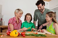 Germany, Bavaria, Nuremberg, Family cutting vegetables