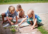 Germany, Bavaria, Group of children drawing on walkway with chalk