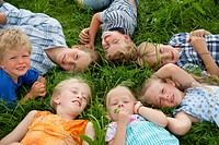 Germany, Bavaria, Group of children lying in meadow