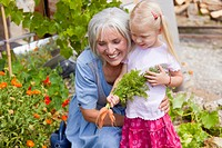 Germany, Bavaria, Mature woman with girl in garden