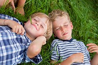 Germany, Bavaria, Boys lying in meadow