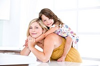 Germany, Mother and daughter having fun, smiling (thumbnail)