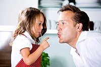 Germany, Daughter eating noodles with father in kitchen (thumbnail)