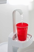 Germany, Water dispenser with disposable cup in dental office