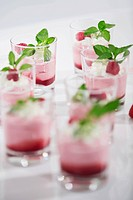 Glasses of yogurt with raspberries and mint leaves