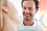 Germany, Dentist and patient in clinic, smiling