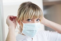 Germany, Dentist with surgical mask