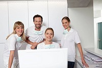 Germany, Dentist and assistance smiling, portrait