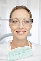 Germany, Dentist with safety glasses in dental office
