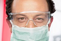 Germany, Dentist with safety glasses and surgical mask in dental office
