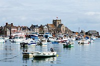 Barfleur harbour and town across the sea, Normandy, France