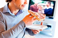 Man eating pizza.