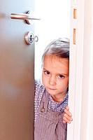 4 year old girl opening a door.