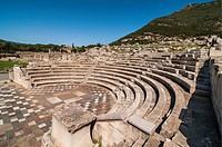 The Ekklesiasterion, assembly hall, at Ancient Messene Ithomi with the modern village of Mavromati in the background, Messinia, Southern Peloponnese, ...