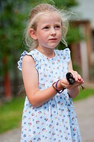 Germany, Bavaria, Girl holding baby chick on farm