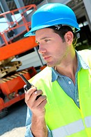 Foreman using walkie_talkie on construction site