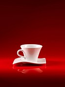 white cup of coffee on red background