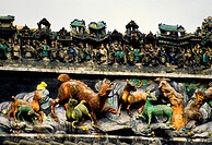Decoration on roof of Chen Clan Academy ancestral hall housing the Guangdong Folk Art Museum in Guangzhou China