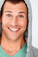Handsome hoodie_clad young man with an excited expression _ isolated