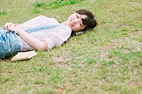 Japanese woman sleeping on the grass