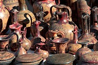 A view of amphorae for sale at a market.