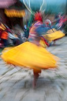Asia, Bhutan, Bumthang. Twirling dancer at Domkhar Tshechu festival. Credit as: Dennis Kirkland / Jaynes Gallery / DanitaDelimont.com