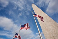The Washington Monument, fronted by Stars and Stripes flags, USA.