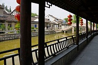 Traditional houses and long corridor along the Grand Canal in the water town, Fengjing, Shanghai, China