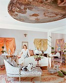 Woman Sitting in Opulent Bedroom