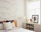 Delicate Wire Sculpture Hanging on Wall Over Bed