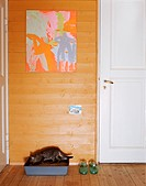 Artwork and Litter Box in Hallway