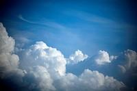 Blue sky and fluffy cumulus clouds