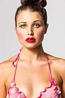 Young woman with bikini top and makeup