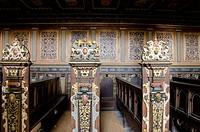 Denmark, Helsingoer. Kronborg Castle aka Kronborg Slot. Ornate carved wooden chruch pew.