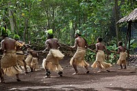 South Pacific, Vanuatu, Port Vili, Ekasup Village. Warriors and young boys performing traditional dance for tourists.