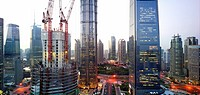 The construction of the Shanghai Tower in Shanghai, China next to the Shanghai World Financial Center and the Jin Mao Tower