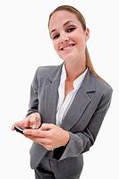 Portrait of a smiling businesswoman using a smartphone