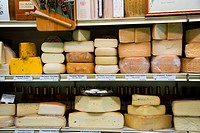 Rounds of cheese line shop shelves in Marostica, Italy