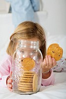 Girl with her hand in the cookie jar