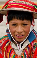 Portrait of young boy, with traditional dress in small town of Pisaq Peru South America