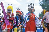 Three Native Americans in full costume performing Corn Dance ceremony in Santa Clara Pueblo, NM