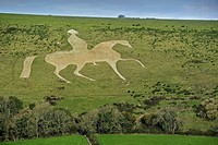 The Osmington White Horse, hill figure of George III on horseback sculpted in 1808 into the limestone Osmington hill along the Jurassic Coast, Dorset,...