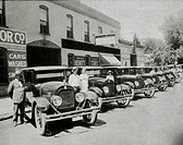 People Posed With Row of Automobilies, USA, 1921