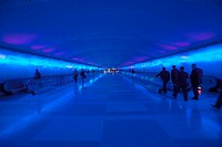 Moving sidewalks and a changing light show in the tunnel of the Detroit Airport, Detroit, Michigan