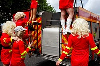 People climbing onto the back of a fire engine during Bristol Gay Pride