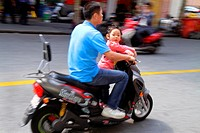 China, Shanghai, Huangpu District, Sichuan Road, Asian, man, girl, motor scooter, no helmet, couple, transportation, safety, dangerous,