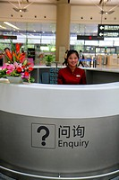 China, Shanghai, Changning District, Hongqiao Airport, Terminal 2, SHA, service desk, information, Asian, woman, Mandarin symbols, hanzi, English lang...