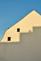 rooftops of houses in the Ceramique neighbourhood of Maastricht with shadows on the building
